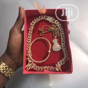 Crystal Iced Cuban Choker With Money Bag Pendant and Nail Bracelet | Jewelry for sale in Lagos State, Lagos Island