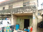 Land With Demolishable Upstairs On Ajibulu Street Off Int Airport Road | Houses & Apartments For Sale for sale in Lagos State, Oshodi-Isolo